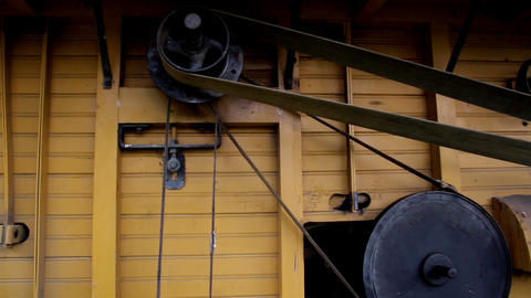 The Home Made Old Time Noisy Farm Machine And The  stock footage