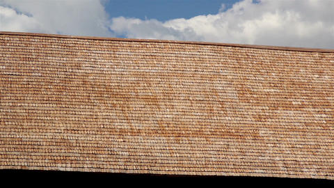 Large and Brown wooden tar colored shingle roof Live Action