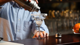 Bartender Serving A Margarita Cocktail Footage