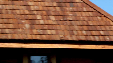 The tar oiled cedar wooden shingle rooftop of the  Live Action