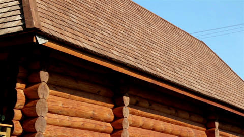 Brown colored log house with tar oiled cedar woode Live Action