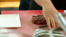 Cutting Half Raw Steak For Service 04 stock footage