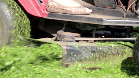 Lawn mower effectively cutting off the tall grasse Footage