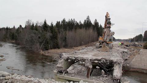 River flowing under the damaged bridge Footage