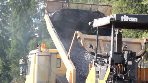 Dumptruck dumping gravel in the site Footage