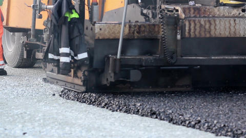 Asphalt paver applying asphalt on the highway Footage
