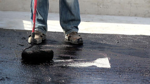 Road Men Manually Applying Asphalt On The Highway stock footage