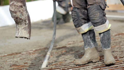 Cement Mixer Pouring Cement On The Ground stock footage