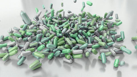 Pills drugs capsules falling on white table counte Animation