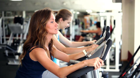 Using Exercise Bikes stock footage
