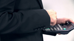 Sliding Shoot Of Business Man Typing On Calculator stock footage