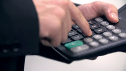 Close Up On Businessman Fingers Calculating stock footage