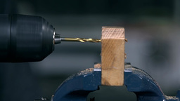 Close Up Detail Of Drilling A Hole Through Wood stock footage