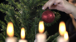 Hanging Christmas Decorations On Pine Tree stock footage