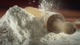 Falling Flour On Wooden Surface In Super Slow Moti stock footage