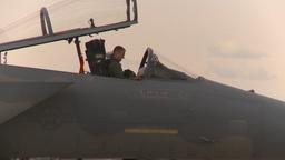 HD2009-6-6-34 apron F15 line pilot putting on helmet Stock Video Footage