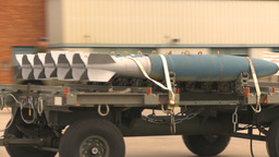 HD2009-6-7-10 bombs on trailer moving Stock Video Footage