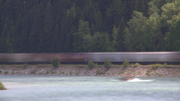 HD2009-6-8-14b train on river tl Stock Video Footage