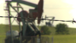 HD2009-6-19-7 pumpjack barb wire rack focus Stock Video Footage