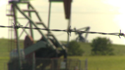 HD2009-6-19-7 pumpjack barb wire rack focus Footage