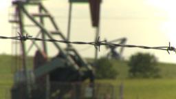 HD2009-6-19-7 pumpjack barb wire rack focus Footage