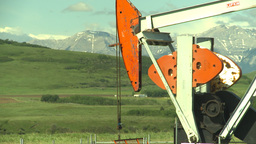 HD2009-6-19-19 pumpjack and cars Footage