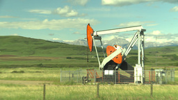 HD2009-6-19-19 pumpjack and cars Stock Video Footage