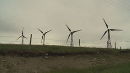 HD2009-6-20-39 wind turbines on ridgebarb wire Stock Video Footage
