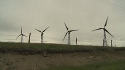 HD2009-6-20-39 wind turbines on ridgebarb wire Stock Video Footage