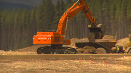 HD2009-6-22-4 backhoe and large dump truckLLL Stock Video Footage
