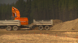 HD2009-6-22-6 backhoe and large dump truck LLL Footage