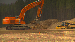 HD2009-6-22-6 backhoe and large dump truck LLL Stock Video Footage