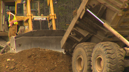 HD2009-6-22-8 dump truck and dozer LLL Stock Video Footage