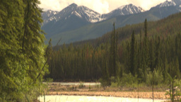 HD2009-6-22-10 river to mountains tilt up Stock Video Footage