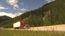 HD2009-6-22-12 transport trucks mountains Stock Video Footage