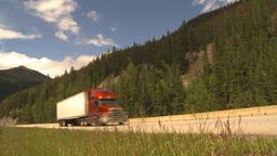 HD2009-6-22-12 transport trucks mountains Footage
