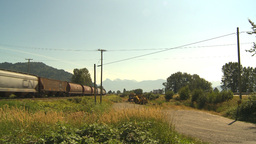HD2009-6-27-16 freight train and highway Stock Video Footage