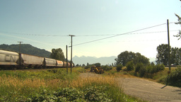 HD2009-6-27-16 freight train and highway Footage
