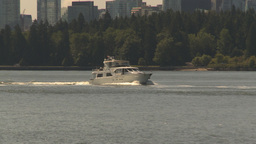 HD2009-6-31-3 pleasure boat and zoom back skyline Stock Video Footage