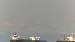 HD2009-6-31-5 cargo ships in strait tilt down reveal Stock Video Footage