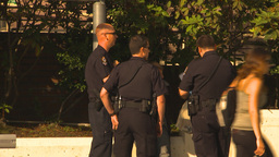 HD2009-6-33-2 police cars and cops 2shot Stock Video Footage