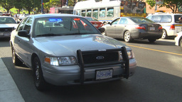 HD2009-6-33-4 unmarked police cars 2shot Stock Video Footage
