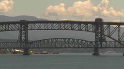 HD2009-6-33-16 traffic over bridge TL clouds Stock Video Footage