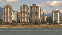 HD2009-6-33-38 TL condos traffic sailboats Stock Video Footage