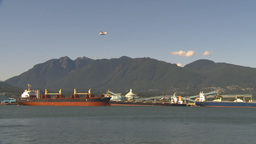 HD2009-6-34-23 float plane flies past cargo ship incoming Stock Video Footage