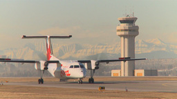 HD2009-3-1-12 Dash-8 taxi Mtns in bg Stock Video Footage