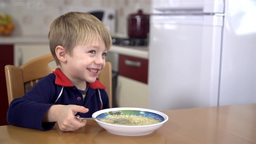 Young Boy In Kitchen Smiling stock footage