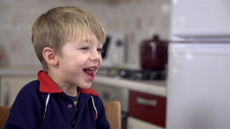 Little Boy Smiling At Lunch stock footage