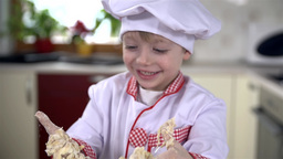 Little Cook Smiling At His Funny Hands stock footage