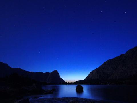 Mountain Lake. Day follows night. Pamir, Tajikista Footage